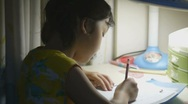 Stock Video Footage of Asian kid doing homework