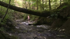 Girl goes to bed of a mountain stream in the North Caucasus Stock Footage