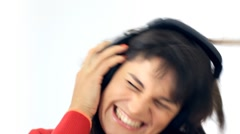 Exited woman in headphones listening to the music, isolated Stock Footage