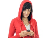 Stock Video Footage of Portrait of smiling woman in the hood sending sms, isolated on white