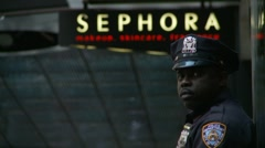 Sephora NYC cop (slow motion) Stock Footage