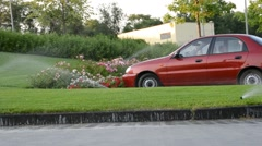 Car. Watering of grass Stock Footage