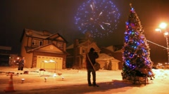 Firework in sky during a meeting of new year, in street there is high christmas Stock Footage