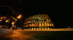 Street with cars near illuminated Colosseum in Rome Stock Footage