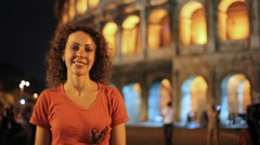 Women standing near Colosseum in Rome Stock Footage