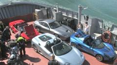 Cars on ferry, 3 Ferrari's, 1 Lotus Stock Footage