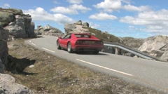 Cars driving on a mountain road Stock Footage