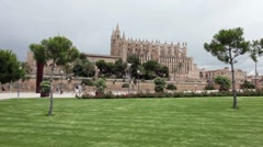 Palma Mallorca Cathedral across park P HD 1480 Stock Footage