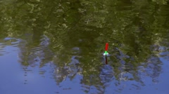 Float fishing is reflected in the water Stock Footage