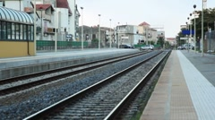 Platform and railway lines near train station Stock Footage