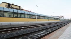 Train arrive to platform near railway station Stock Footage