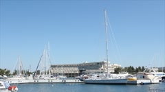 Port with yacht and boats Stock Footage