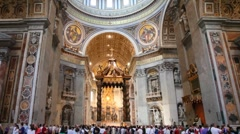 Central nave of St. Peters Basilica (Basilica di San Pietro) in Vatican Stock Footage