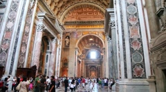 People in central nave St. Peters Basilica (Basilica di San Pietro) Stock Footage