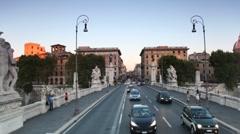 Riding through bridge Ponte Vittorio Emanuele II across Tiber Stock Footage