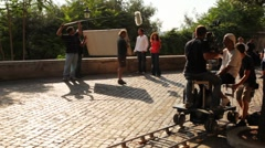 Operator and actors shooting episode of film near Villa Medici Stock Footage