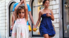 Little girl was lost and stands among bustling city - stock footage