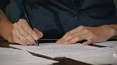 Women signs contract - stock footage
