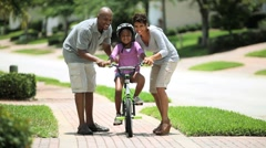 African American Child Practicing on her Bicycle Stock Footage