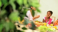 Stock Video Footage of Young Ethnic Family Sharing Healthy Lunch