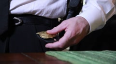 Detective putting his badge on Stock Footage