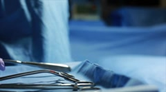 nurse handing surgeon tools - stock footage