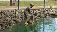 Stock Video Footage of Puerto Rico - Statues of Children  in Pond
