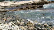 Incoming tide and granite pebbles 0444 Stock Footage