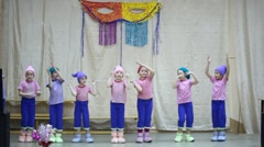 Children in gnomes fancy-dress appear on stage Stock Footage