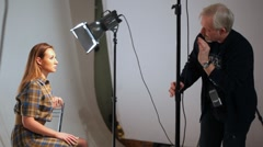 Yakov Titov gives master-class how to photograph model in studio Stock Footage