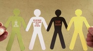 Stock Video Footage of Stop racism (version 2). Black and white paper people, together