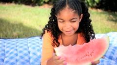 Little African American Girl Eating Fresh Fruit Stock Footage