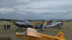 Clip of several restored planes flying over us in France. Stock Footage