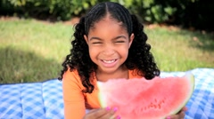 Little Ethnic Girl Enjoying Watermelon Stock Footage