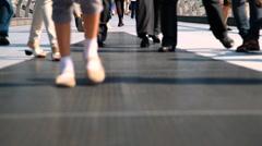 People walking over Millennium Bridge in London towards camera Stock Footage