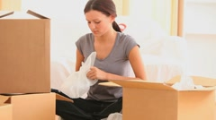 Woman preparing boxes to move out Stock Footage