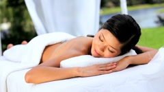 Beautiful Asian Girl Having Hot Stone Massage Therapy Stock Footage