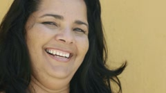 Mature hispanic overweight woman smiling at camera - stock footage