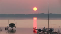 Sunset on a bay with boats and docks Stock Footage
