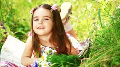 Little girl lying in the grass Stock Footage