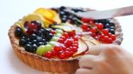 Cutting tasty fruitcake Stock Footage