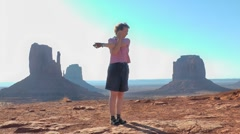 Stretching excercises, Monument Valley, Arizona, USA Stock Footage