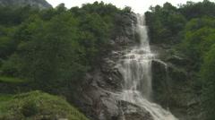 A waterfall ins swizerland slow motion Stock Footage