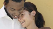 Young interracial couple dating and hugging Stock Footage