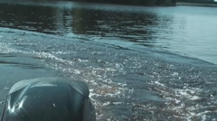 Motorboat floats on lake. Stock Footage
