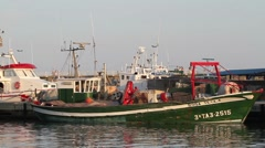 Fishing ship in a harbour. Stock Footage