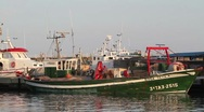Stock Video Footage of Fishing ship in a harbour.