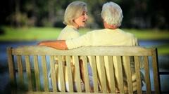 Senior Couple Enjoying Golden Years Outdoors in Park Stock Footage