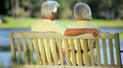 Older Couple on Park Bench Enjoying the View - stock footage