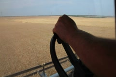 Farmer driving combine harvester Stock Footage